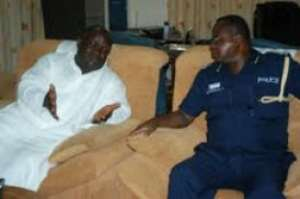 Mr Kenneth Ashigbey - MD of GCGL (Left), in a discussion with Western Regional Police Commander, Ransford Moses Ninson