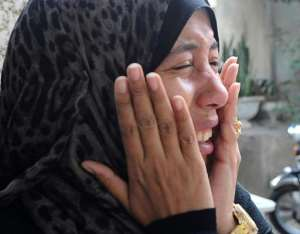 A woman mourns during the funeral of Shaima al-Sabbagh, an Egyptian protester who was killed in clashes with the police in Alexandria, on January 25, 2015.  By Tarek Abdel Hamid (AFP)
