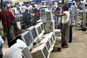 A used-computer vendor attends to a buyer at Lagos' computer village in 2006.  By Pius Utomi Ekpei (AFP/File)