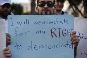 A Libyan man holds a sign during a protest  in Tripoli on September 28, 2012.  By Gianluigi Guercia (AFP/File)