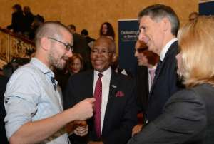 British Ebola survivor William Pooley (L) talks with Sierra Leone's High Commissioner to Britain Edward Turay (C) and British Foreign Secretary Philip Hammond (2nd R) at the Ebola conference in London, on October 2, 2014.  By Leon Neal (Pool/AFP)