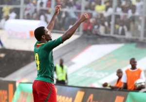 Cameroon's forward Samuel Eto'o celebrates qualifying for the 2014 FIFA World Cup in Brazil after winning the second leg qualifying football match between Cameroon and Tunisia on November 17, 2013 in Yaounde.  By Hosni Manoubi (AFP)