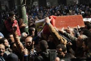 Mourners carry a coffin during the funeral of activists Amro Saad and Mohammed al-Guindi in Cairo on February 4, 2013.  By Gianluigi Guercia (AFP)
