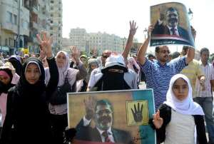 Supporters of Mohamed Morsi demonstrate against the military on September 20, 2013 along the seafront in the northern coastal city of Alexandria.  By  (AFP/File)