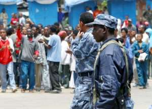 File photo shows Ethiopian policemen guarding a demonstration in Addis Ababa on June 6, 2005.  By Lea-Lisa Westerhoff (AFP/File)