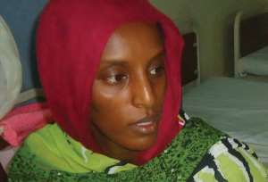 Meriam Yahia Ibrahim Ishag sits in her cell at a women's prison in Omdurman, on May 28, 2014 after giving birth to a baby girl.  By  (AFP/File)