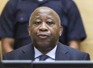Former Ivory Coast President Laurent Gbagbo at a pre-trial hearing on charges of crimes against humanity at the International Criminal Court in The Hague on February 19, 2013.  By Michael Kooren (POOL/AFP/File)