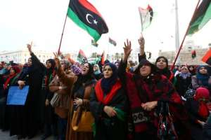 Libyan protesters take part in a rally in Tripoli's central Martyr's Square on February 13, 2015, in support of