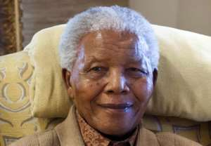 File photo taken on July 17, 2012 shows former South African President Nelson Mandela during a visit by former US president Bill Clinton at his home in Qunu, Eastern Cape.  By Barbara Kinney (Clinton Foundation/AFP/File)