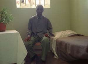 South African President Nelson Mandela visits his former cell on February 10, 1995 off the coast of Cape Town.  By Guy Tillim (AFP/File)