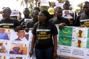 Anti-slavery activists demonstrate in Dakar, Senegal, against the imprisonement of fellow activists in Mauritania, on August 3, 2016.  By Seyllou (AFP/File)