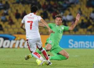 Tunisia's Youssef Msakni (L) vies for the ball with Algeria's Mehdi Mostefa in Rustenburg on January 22, 2013.  By Alexander Joe (AFP)