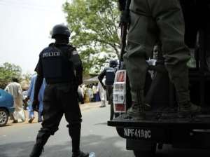 Nigerian police patrol the northern town of Bauchi in April 28, 2011.  By Tony Karumba (AFP/File)