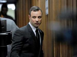 South African paralympian Oscar Pistorius arrives at the High Court in Pretoria for his trial on July 2, 2014.  By Werner Beukes (POOL/AFP)