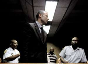 Oscar Pistorius leaves the court room on February 15, 2013 at the Magistrate Court in Pretoria.  By Stephane de Sakutin (AFP)
