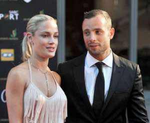 Steenkamp and Pistorius are seen at Feather Awards in Johannesburg on November 4, 2012.  By Lucky Nxumalo (AFP/File)