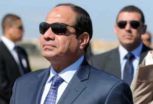 Egypt's president Abdel Fattah al-Sisi reviews troops upon his arrival at Houari-Boumediene International Airport on June 25, 2014 in Algiers.  By Farouk Batiche (AFP/File)