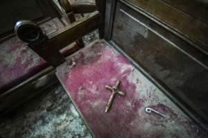 The damage following a bomb explosion at the Saint Peter and Saint Paul Coptic Orthodox Church on December 11, 2016, in the Abbasiya neighbourhood in Cairo.  By KHALED DESOUKI (AFP/File)