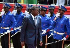 Togo's President Faure Gnassingbe walks past an honour guard in Lome on April 27, 2015.  By Issouf Sanogo (AFP/File)