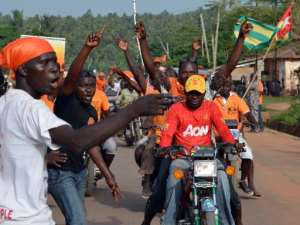 Swarming the streets of Togo's capital Lome, thousands of motorcycle taxi drivers are just some of those left behind by the recent economic growth.  By Issouf Sanogo (AFP/File)