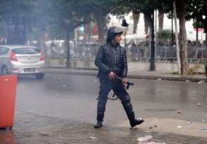 A Tunisian riot officer looks on at protestors  during a rally outside the Interior Ministry on February 6, 2013.  By Fethi Belaid (AFP)