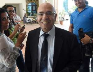 Mohamed Fadhel Mahfoudh arrives for a meeting as part of the dialogue between ruling political parties to try to agree on a timetable for delayed parliamentary and presidential elections on June 11, 2014 in Tunis.  By Fethi Belaid (AFP/File)