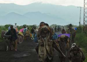 Congolese people flee from Sake on November 23, 2012 to escape a rebel advance in eastern DR Congo.  By Tony Karumba (AFP/File)