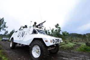 A UN mission in DR Congo (MONUSCO) armored personnel carrier patrols on November 5, 2013 on Chanzu hill, in the eastern North Kivu region.  By Junior D. Kannah (AFP/File)