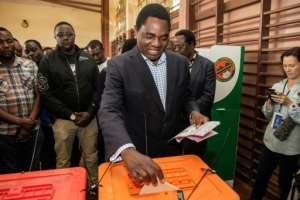 Zambian presidential candidate Hakainde Hichilema of main opposition party United Party for National Development, looks on after casting his ballot during the Zambian general elections on August 11, 2016.  By Gianluigi Guercia (AFP/File)