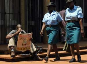 A man reads an issue of the state-controlled daily The Herald in Harare on March 19, 2013.  By Alexander Joe (AFP)