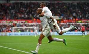 Andre Ayew celebrates one his heroic moments in England