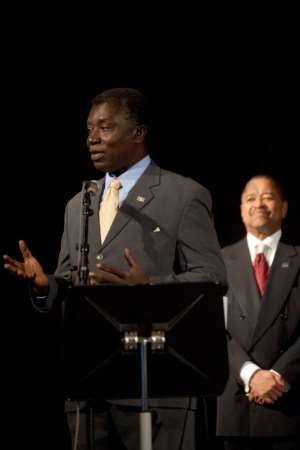 Professor Kwabena Frimpong-Boateng delivering his acceptance speech with OU President Roderick McDavis behind.
