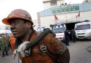 AP – A rescue worker emerges from the pit entrance to the Tunlan Coal Mine in Gujiao, in China s Shanxi province, …