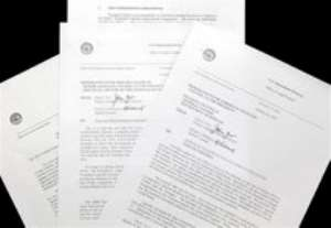 AP – Justice Department memos from 2001 are seen in Washington Monday, March 2, 2009. The Justice Department …