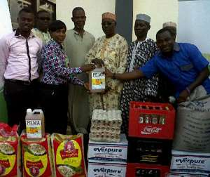 Akosua Aboagye (3rd left) presenting the items to the muslim leaders