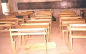 World Vision has presented 150 pieces of dual desks to the Kintampo South GES