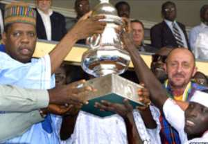 Jacob Nettey (L), receiving the 200 champions league trophy that Hearts won from Issa Hayatou, where did all the money go