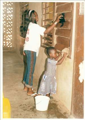 A volunteer and student from Mother Teresa School for Girls show that two hands are better than one