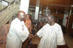 Brong Ahafo Regional Minister, Mr Nyamekye-Marfo (R) welcoming Graphic MD, Mr Ken Ashigbey (L) to his office