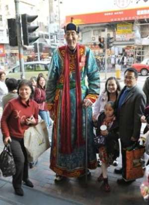 Bao Xishun is listed by the Guinness World Records as the world s tallest man.