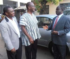 Mr. Hammah, 2nd left, Dr. W. Odame Larbi, CEO, Lands Commission, (left) and Nana Adjei Ampofo, National Chairman Land Commission (right) in a chat after the close door meeting