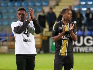 Eugene Ansah with deceased Lokeren team-mate Gregory Mertens