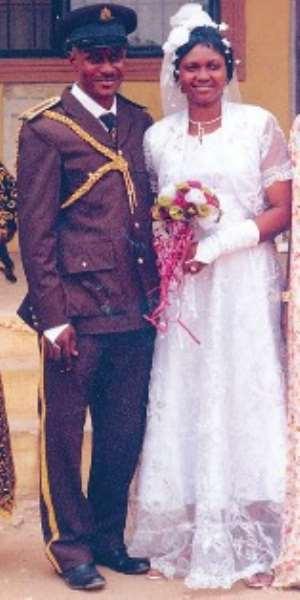 Gbenga and wife on wedding day