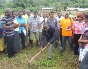 The DCE, Daniel Eshun, breaking the ground for the start of the project