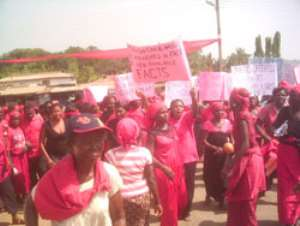 The youth of Vakpo in a demonstration against the siting of the new North Dayi District capital at Anfoega, through principal streets of Vakpo