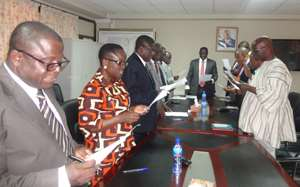 Energy Minister (at head of table) swearing in the reconstituted board