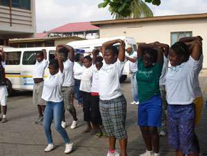 A section of the children undertaking aerobic exercises after the walk