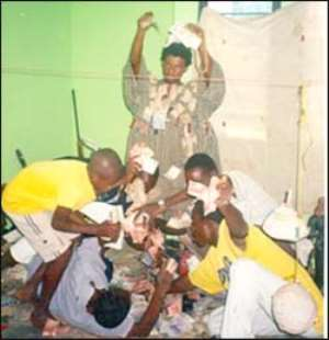 Nana Abosom Akutre conjuring the money