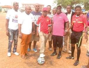 Ayisi Boateng kicking the ball to start the gala as Sir John, Nana B and others look on