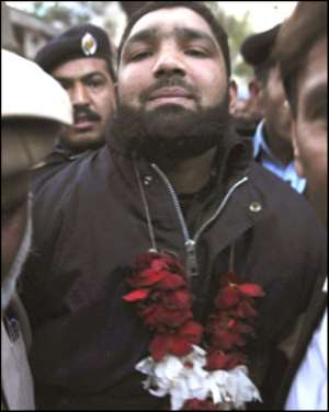 Killer Qadri Garlanded